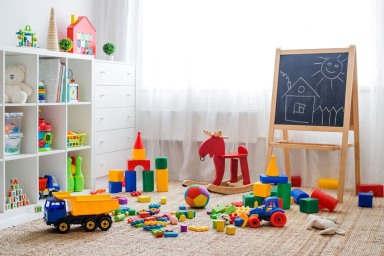 room with chalk board and colorful kids toys
