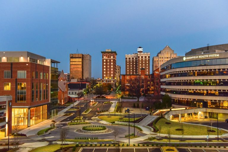 downtown greenville at dusk with building lit up