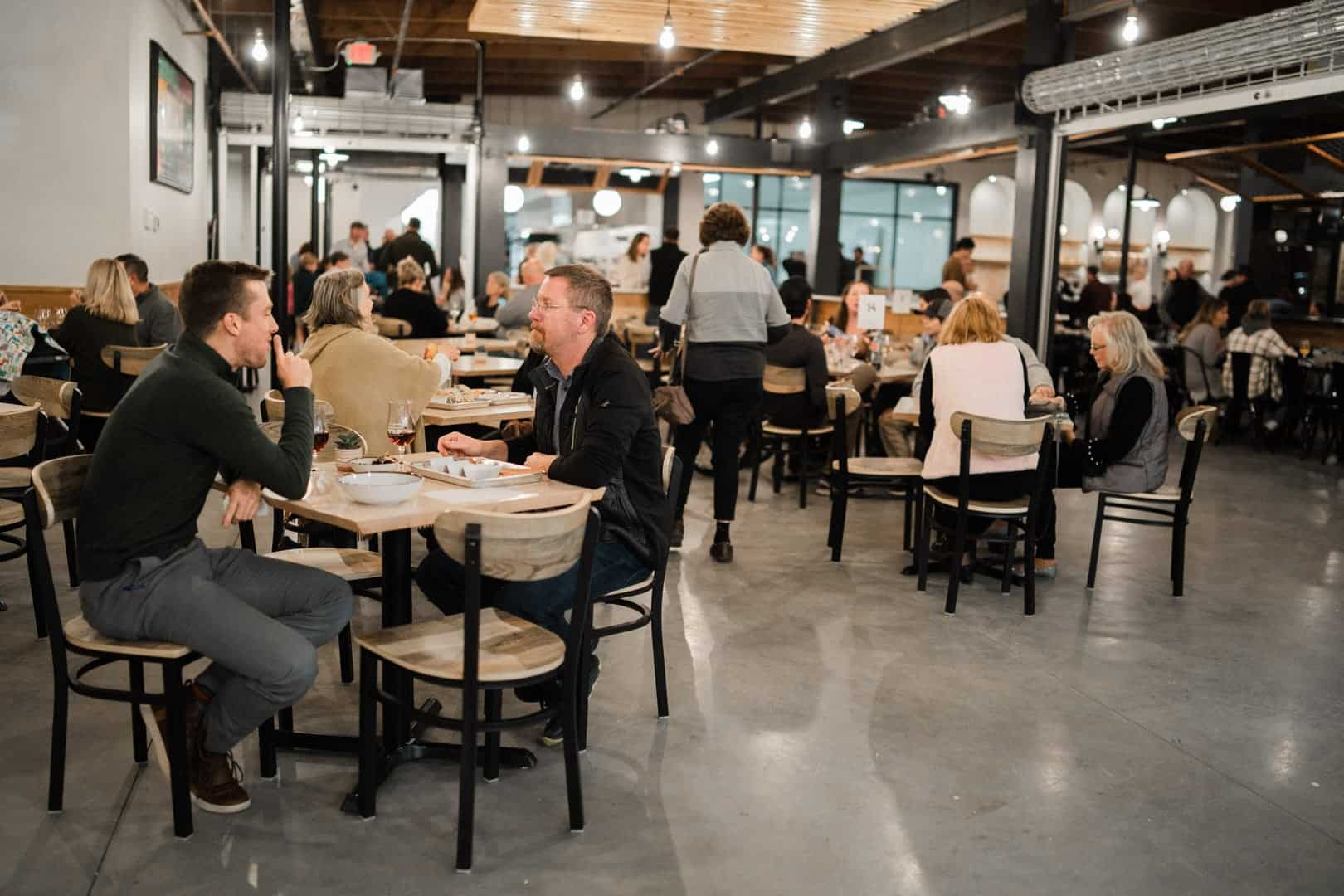 interior of the commons food hall with people sitting at tables