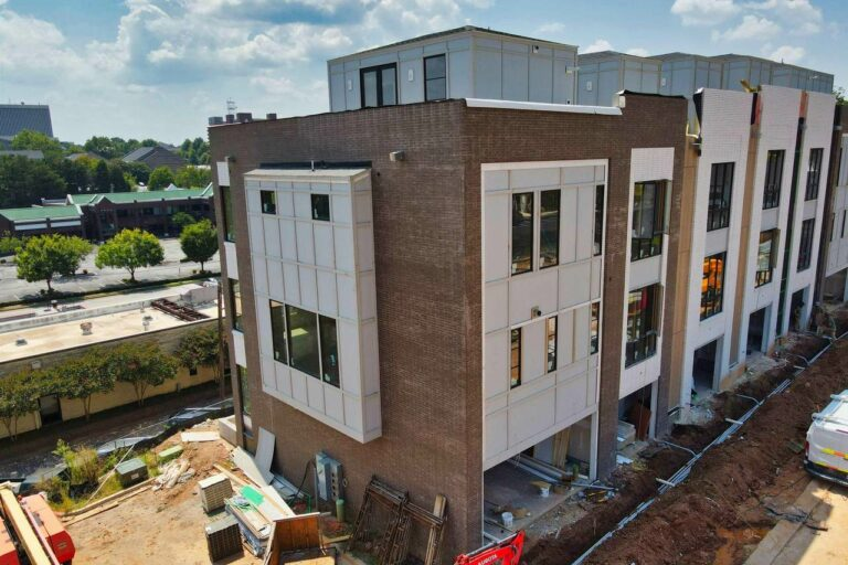 exterior of noma townhomes in construction
